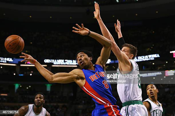 Spencer Dinwiddie of the Detroit Pistons makes a pass with pressure from Jonas Jerebko of the Boston Celtics during the first quarter at TD Garden on...