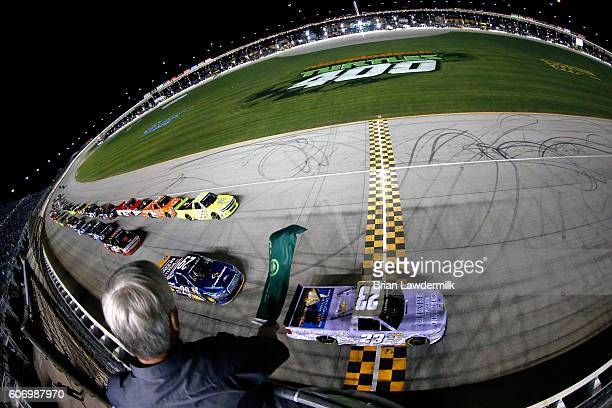 Spencer Gallagher driver of the Chapel of the Flowers Chevrolet leads the field to the green flag to start the NASCAR Camping World Truck Series...