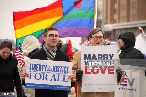 Spencer Geiger and Carl Johansen protest for equal marriage outside the Walter E Hoffman US Courthouse as oral arguments in the case of Bostic v...