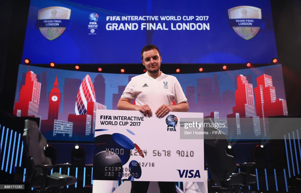 Spencer 'Gorilla' Ealing of England celebrates with his cheque after his victory in the final against Kai 'Deto' Wollin of Germany during day three of the FIFA Interactive World Cup 2017 Grand Final at Central Hall Westminster on August 18, 2017 in London, England.
