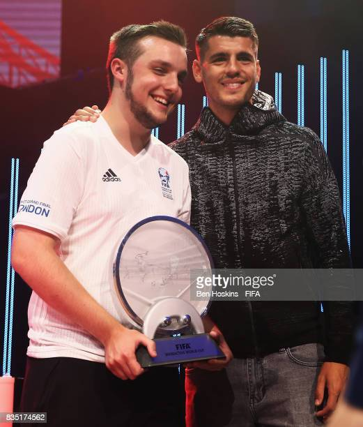 Spencer 'Gorilla' Ealing of England celebrates with the trophy and Alvaro Morata of Chelsea after his victory in the final against Kai 'Deto' Wollin...