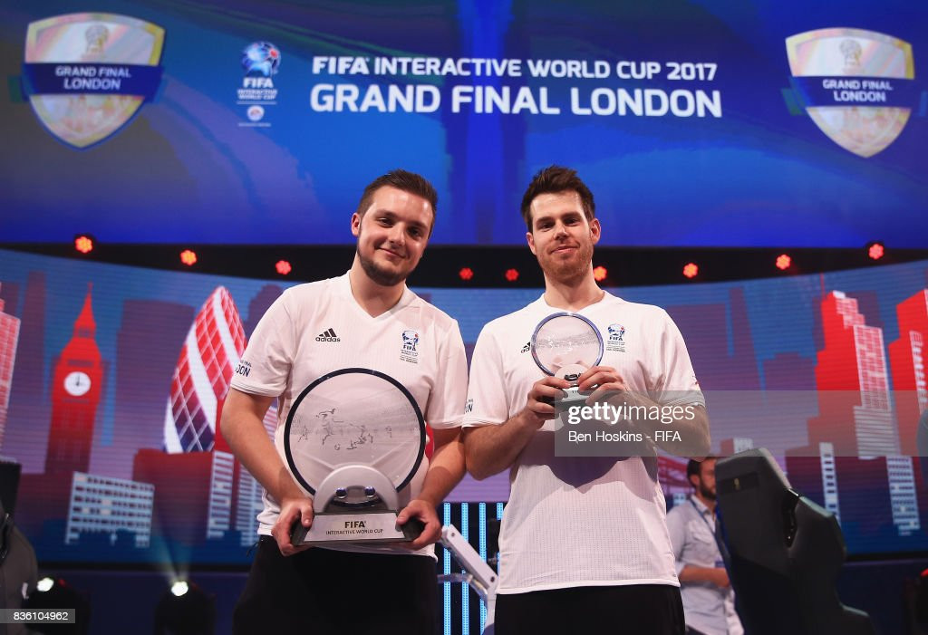 Spencer 'Gorilla' Ealing (L) of England poses with his trophy after his victory in the final against Kai 'Deto' Wollin (R) of Germany during day three of the FIFA Interactive World Cup 2017 Grand Final at Central Hall Westminster on August 18, 2017 in London, England.