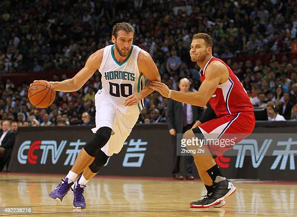 Spencer Hawes of Charlotte Hornets in action against Blake Griffin of Los Angeles Clippers during the match between Charlotte Hornets and Los Angeles...