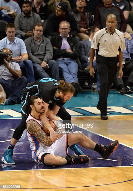 Spencer Hawes of Charlotte Hornets in action against Steven Adams of Oklahoma City Thunder during the NBA match between Oklahoma City Thunder vs...
