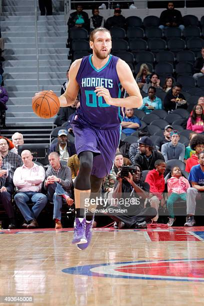 Spencer Hawes of the Charlotte Hornets brings the ball up court against the Detroit Pistons on October 21 2015 at The Palace of Auburn Hills in...