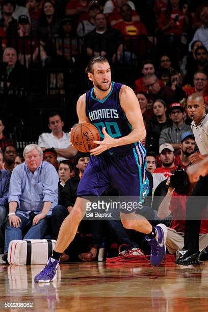 Spencer Hawes of the Charlotte Hornets handles the ball against the Houston Rockets on December 21 2015 at the Toyota Center in Houston Texas NOTE TO...