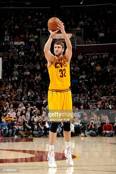 Spencer Hawes of the Cleveland Cavaliers shoots against the Oklahoma City Thunder at The Quicken Loans Arena on March 20 2014 in Cleveland Ohio NOTE...