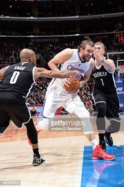 Spencer Hawes of the Los Angeles Clippers drives against the Brooklyn Nets on January 22 2014 at STAPLES Center in Los Angeles California NOTE TO...