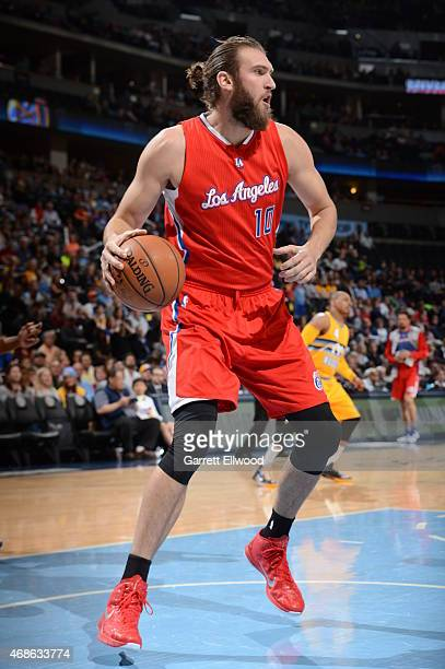 Spencer Hawes of the Los Angeles Clippers handles the ball against the Denver Nuggets on April 4 2015 at the Pepsi Center in Denver Colorado NOTE TO...