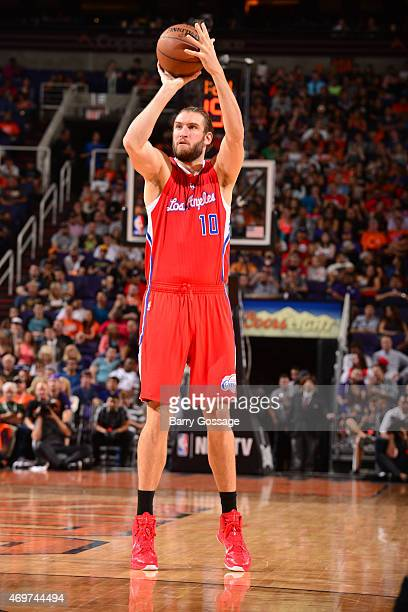 Spencer Hawes of the Los Angeles Clippers shoots against the Phoenix Suns on April 14 2015 at US Airways Center in Phoenix Arizona NOTE TO USER User...