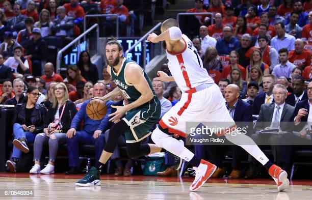Spencer Hawes of the Milwaukee Bucks dribbles the ball as Jonas Valanciunas of the Toronto Raptors defends in the first half of Game Two of the...