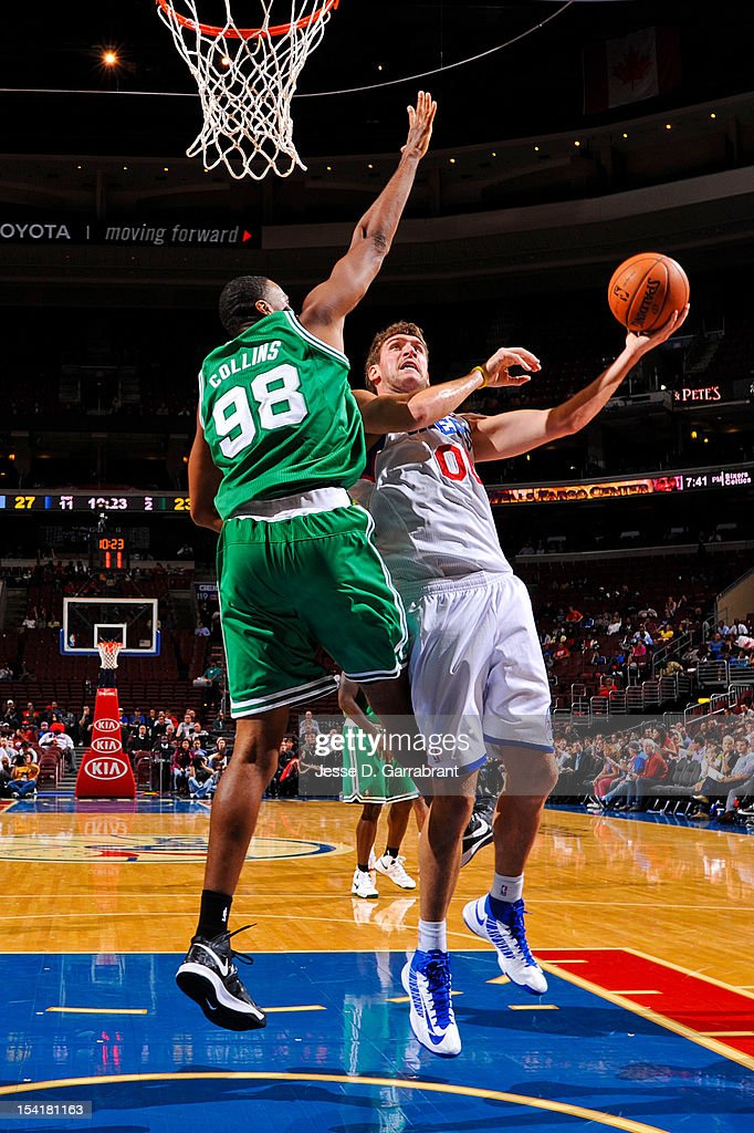 Spencer Hawes #00 of the Philadelphia 76ers attempts a shot against Jason Collins #98 of the Boston Celtics during a pre-season game at the Wells Fargo Center on October 15, 2012 in Philadelphia, Pennsylvania.
