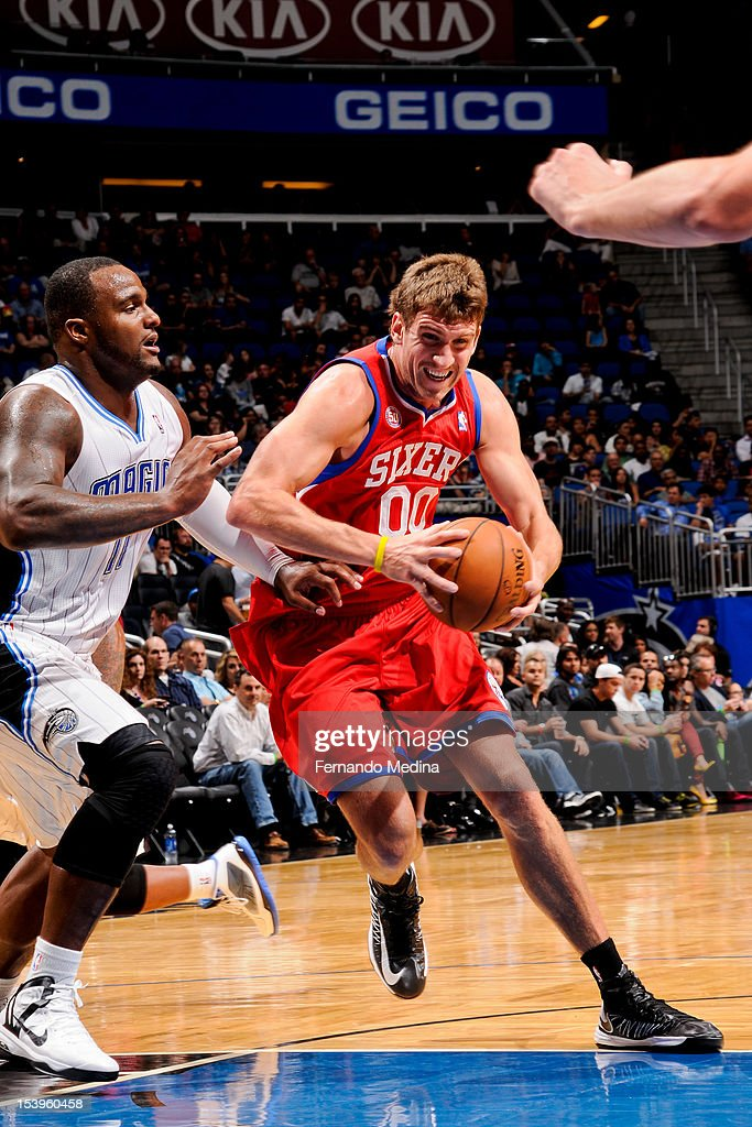 Spencer Hawes #00 of the Philadelphia 76ers drives against Glen Davis #11 of the Orlando Magic during a pre-season game on October 11, 2012 at Amway Center in Orlando, Florida.