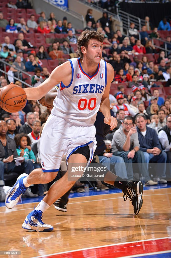 Spencer Hawes #00 of the Philadelphia 76ers drives to the basket against the Utah Jazz at the Wells Fargo Center on November 16, 2012 in Philadelphia, Pennsylvania.