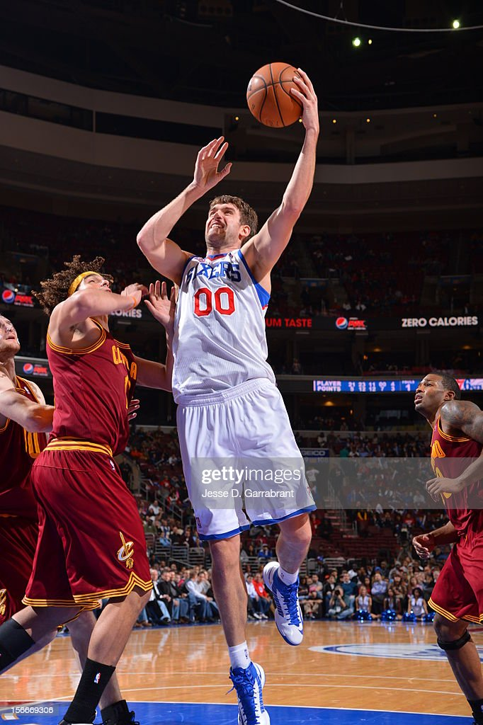 Spencer Hawes #00 of the Philadelphia 76ers drives to the basket against the Cleveland Cavaliers at the Wells Fargo Center on November 18, 2012 in Philadelphia, Pennsylvania.