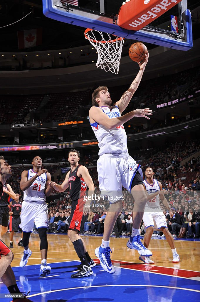Spencer Hawes #00 of the Philadelphia 76ers drives to the basket against the Toronto Raptors at the Wells Fargo Center on November 20, 2012 in Philadelphia, Pennsylvania.