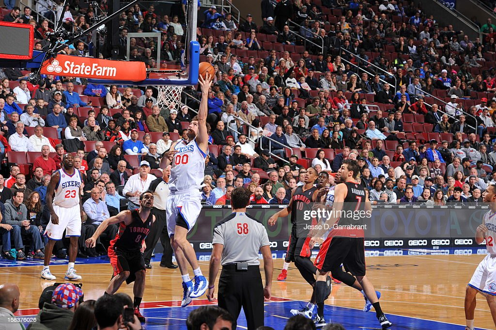 Spencer Hawes #00 of the Philadelphia 76ers drives to the basket against the Toronto Raptors at the Wells Fargo Center on November 20, 2012 in Philadelphia, Pennsylvania.