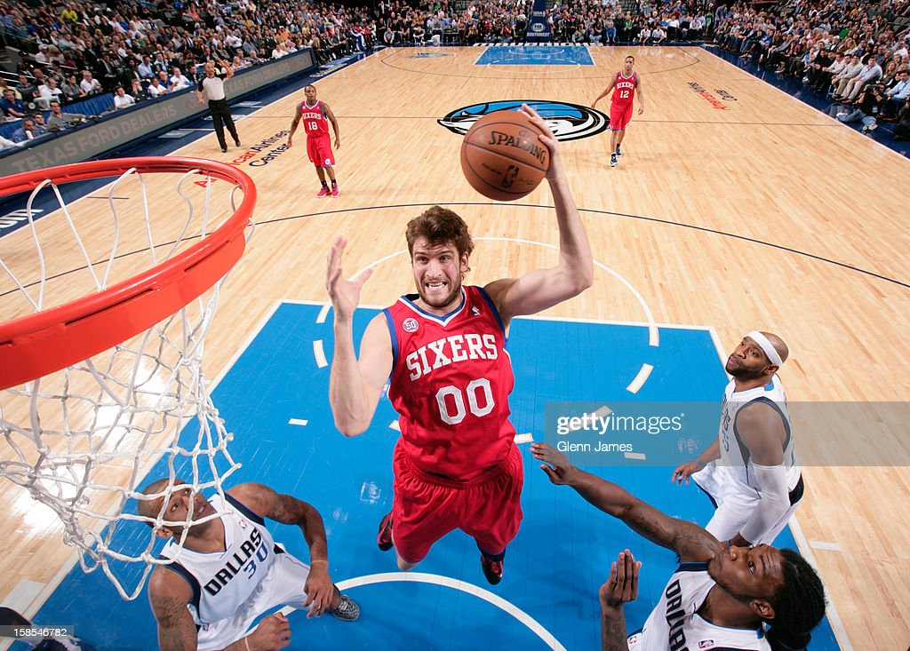<a gi-track='captionPersonalityLinkClicked' href=/galleries/search?phrase=Spencer+Hawes&family=editorial&specificpeople=3848319 ng-click='$event.stopPropagation()'>Spencer Hawes</a> #00 of the Philadelphia 76ers drives to the basket against the Dallas Mavericks on December 18, 2012 at the American Airlines Center in Dallas, Texas.