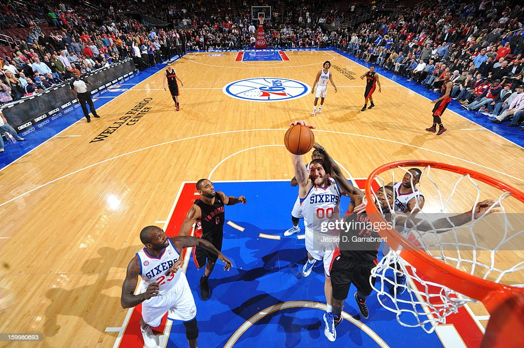 <a gi-track='captionPersonalityLinkClicked' href=/galleries/search?phrase=Spencer+Hawes&family=editorial&specificpeople=3848319 ng-click='$event.stopPropagation()'>Spencer Hawes</a> #00 of the Philadelphia 76ers drives to the basket against the Toronto Raptors at the Wells Fargo Center on January 18, 2013 in Philadelphia, Pennsylvania.