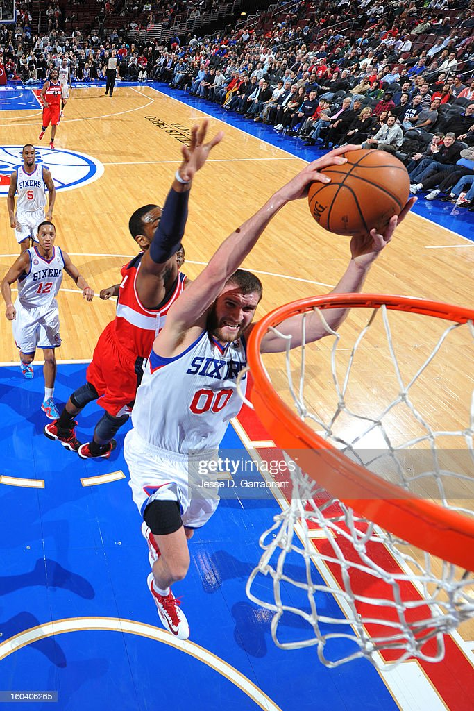 Spencer Hawes #00 of the Philadelphia 76ers drives to the basket against the Washington Wizards at the Wells Fargo Center on January 30, 2013 in Philadelphia, Pennsylvania.