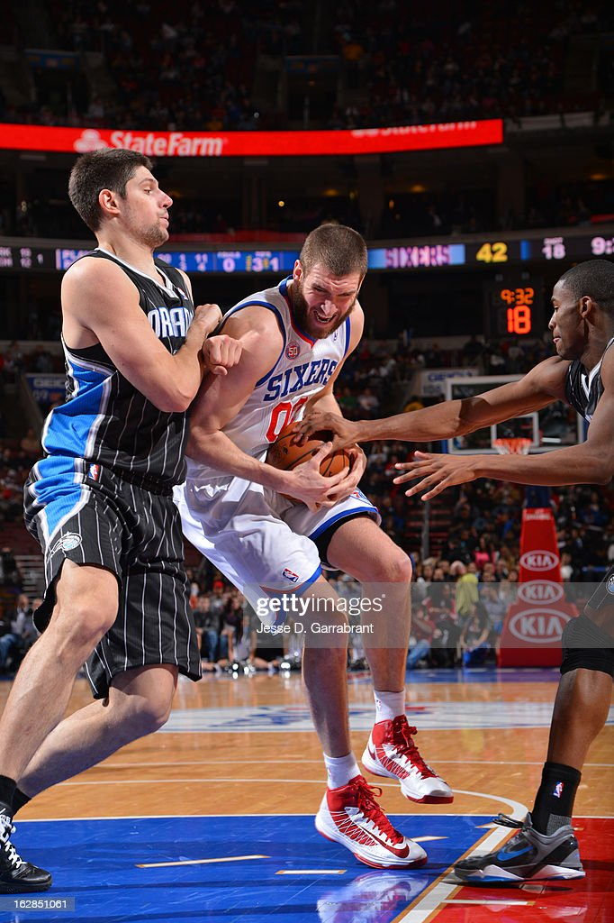 Spencer Hawes #00 of the Philadelphia 76ers drives to the basket against the Orlando Magic at the Wells Fargo Center on February 26, 2013 in Philadelphia, Pennsylvania.