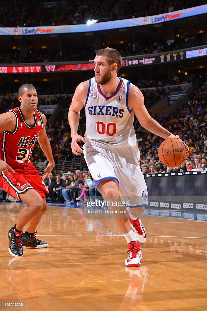 Spencer Hawes #00 of the Philadelphia 76ers drives to the basket against the Miami Heat at the Wells Fargo Center on February 23, 2013 in Philadelphia, Pennsylvania.