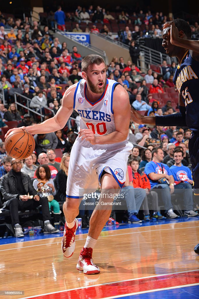 <a gi-track='captionPersonalityLinkClicked' href=/galleries/search?phrase=Spencer+Hawes&family=editorial&specificpeople=3848319 ng-click='$event.stopPropagation()'>Spencer Hawes</a> #00 of the Philadelphia 76ers drives to the basket against the Indiana Pacers at the Wells Fargo Center on March 16, 2013 in Philadelphia, Pennsylvania.