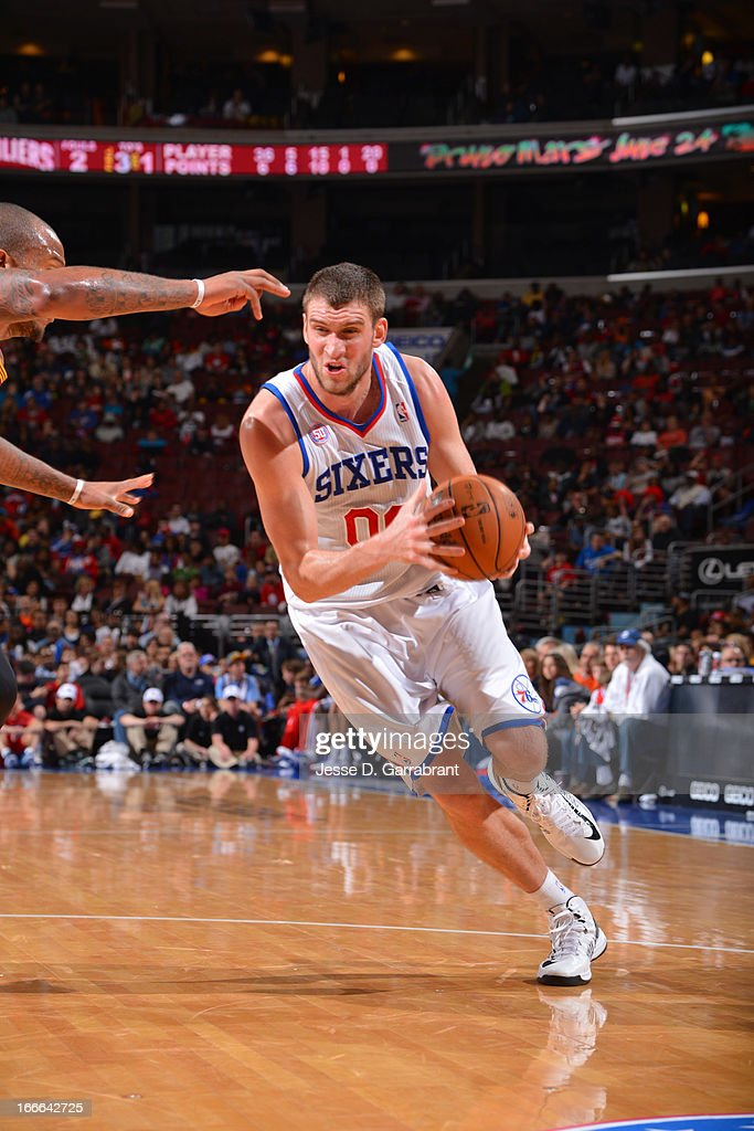 Spencer Hawes #00 of the Philadelphia 76ers drives to the basket against the Cleveland Cavaliers at the Wells Fargo Center on April 14, 2013 in Philadelphia, Pennsylvania.