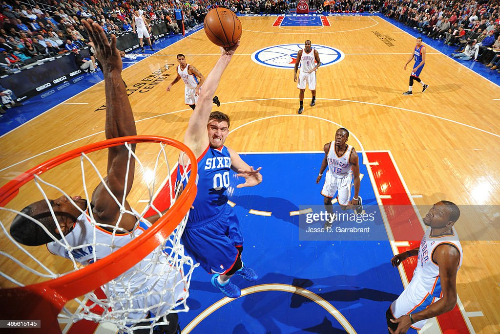 <a gi-track='captionPersonalityLinkClicked' href=/galleries/search?phrase=Spencer+Hawes&family=editorial&specificpeople=3848319 ng-click='$event.stopPropagation()'>Spencer Hawes</a> #00 of the Philadelphia 76ers drives to the basket against the Oklahoma City Thunder at the Wells Fargo Center on January 25, 2014 in Philadelphia, Pennsylvania.