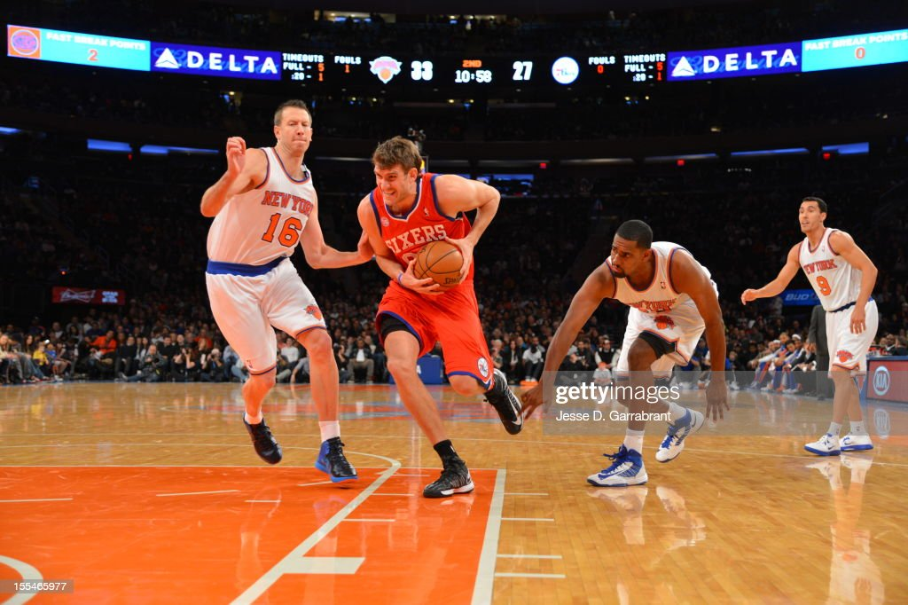 Spencer Hawes #00 of the Philadelphia 76ers drives to the hoop vs Steve Novak #16 of the New York Knicks on November 4, 2012 at Madison Square Garden in New York City.