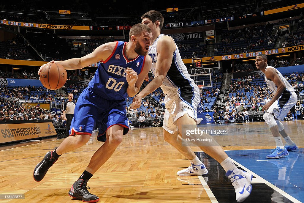 Spencer Hawes #00 of the Philadelphia 76ers drives under pressure during the game between the Philadelphia 76ers and the Orlando Magic on March 10, 2013 at Amway Center in Orlando, Florida.