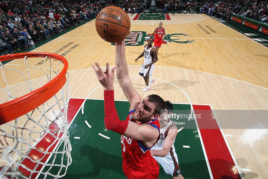 <a gi-track='captionPersonalityLinkClicked' href=/galleries/search?phrase=Spencer+Hawes&family=editorial&specificpeople=3848319 ng-click='$event.stopPropagation()'>Spencer Hawes</a> #00 of the Philadelphia 76ers dunks against <a gi-track='captionPersonalityLinkClicked' href=/galleries/search?phrase=Ersan+Ilyasova&family=editorial&specificpeople=557070 ng-click='$event.stopPropagation()'>Ersan Ilyasova</a> #7 of the Milwaukee Bucks on January 22, 2013 at the BMO Harris Bradley Center in Milwaukee, Wisconsin.