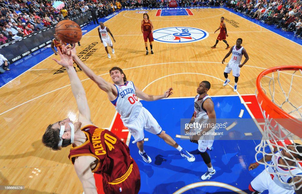 Spencer Hawes #00 of the Philadelphia 76ers fights for the rebound against Tyler Zeller #40 of the Cleveland Cavaliers at the Wells Fargo Center on November 18, 2012 in Philadelphia, Pennsylvania.