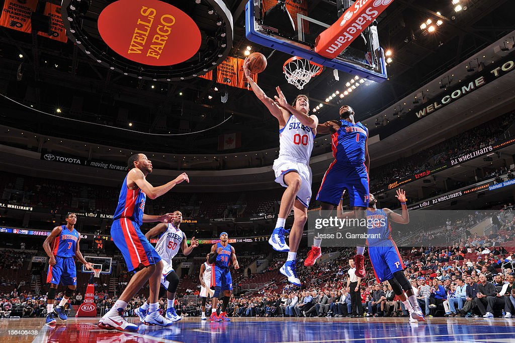 <a gi-track='captionPersonalityLinkClicked' href=/galleries/search?phrase=Spencer+Hawes&family=editorial&specificpeople=3848319 ng-click='$event.stopPropagation()'>Spencer Hawes</a> #00 of the Philadelphia 76ers goes to the basket against <a gi-track='captionPersonalityLinkClicked' href=/galleries/search?phrase=Andre+Drummond&family=editorial&specificpeople=7122456 ng-click='$event.stopPropagation()'>Andre Drummond</a> #1 of the Detroit Pistons during the game between Detroit Pistons and the Philadelphia 76ers at the Wells Fargo Center on November 14, 2012 in Philadelphia, Pennsylvania.