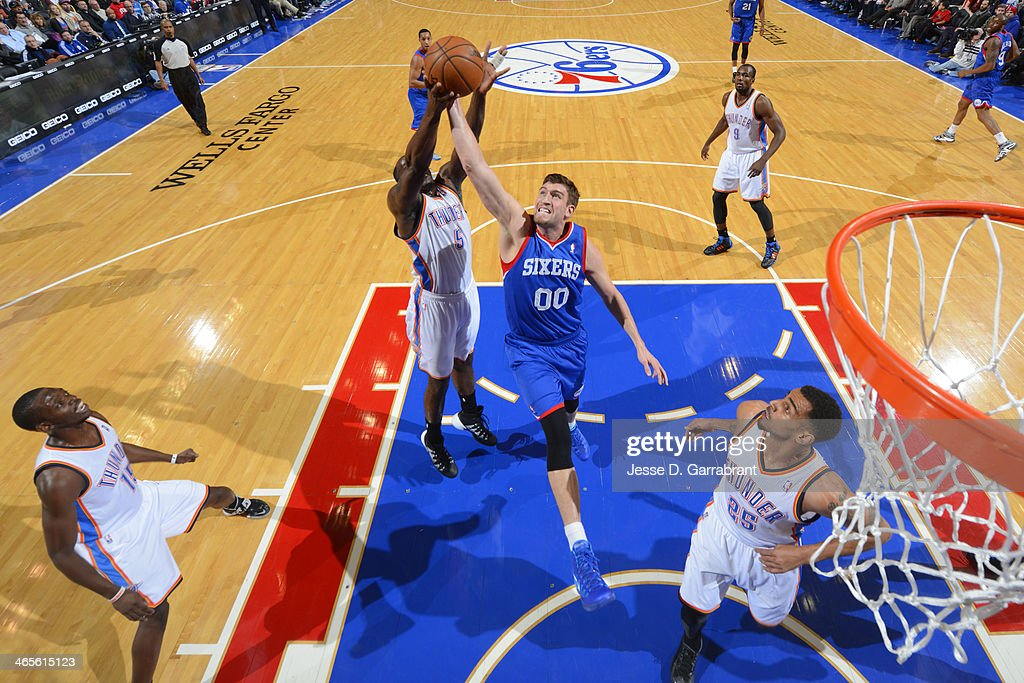<a gi-track='captionPersonalityLinkClicked' href=/galleries/search?phrase=Spencer+Hawes&family=editorial&specificpeople=3848319 ng-click='$event.stopPropagation()'>Spencer Hawes</a> #00 of the Philadelphia 76ers goes up for a rebound against the Oklahoma City Thunder at the Wells Fargo Center on January 25, 2014 in Philadelphia, Pennsylvania.