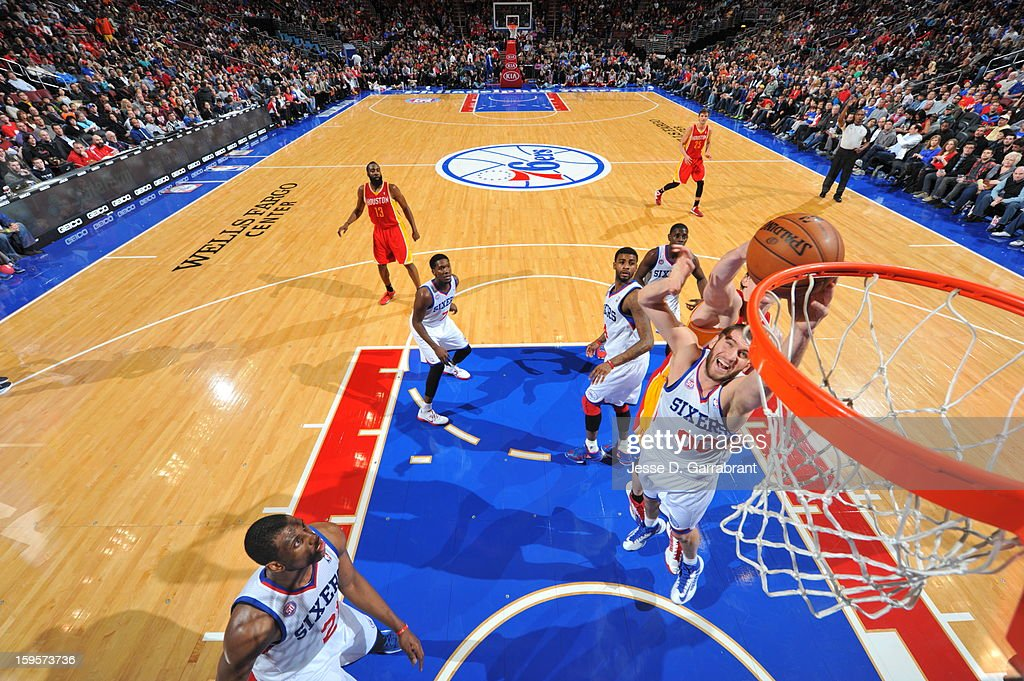 Spencer Hawes #00 of the Philadelphia 76ers grabs a rebound against the Houston Rockets at the Wells Fargo Center on January 12, 2013 in Philadelphia, Pennsylvania.