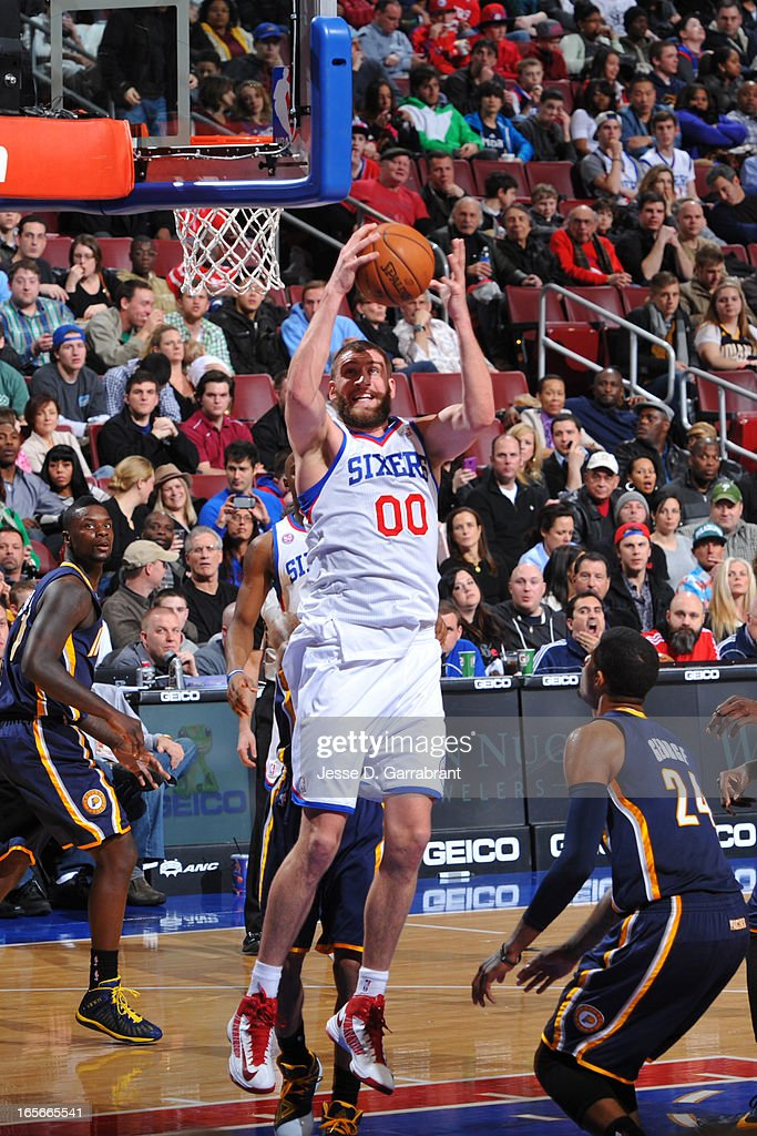 Spencer Hawes #00 of the Philadelphia 76ers grabs a rebound against the Indiana Pacers at the Wells Fargo Center on March 16, 2013 in Philadelphia, Pennsylvania.