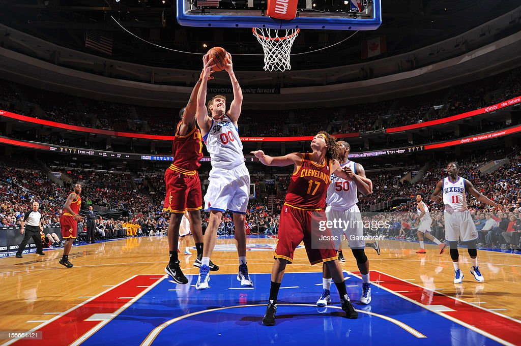 Spencer Hawes #00 of the Philadelphia 76ers grabs the rebound against the Cleveland Cavaliers at the Wells Fargo Center on November 18, 2012 in Philadelphia, Pennsylvania.
