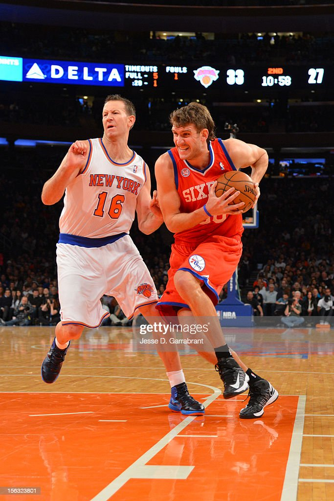 Spencer Hawes #00 of the Philadelphia 76ers handles the ball against Steve Novak #16 of the New York Knicks on November 4, 2012 at Madison Square Garden in New York City.