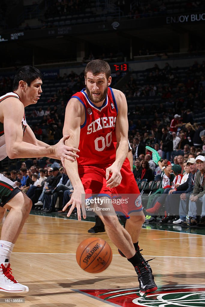 Spencer Hawes #00 of the Philadelphia 76ers handles the ball against Ersan Ilyasova #7 of the Milwaukee Bucks on February 13, 2013 at the BMO Harris Bradley Center in Milwaukee, Wisconsin.
