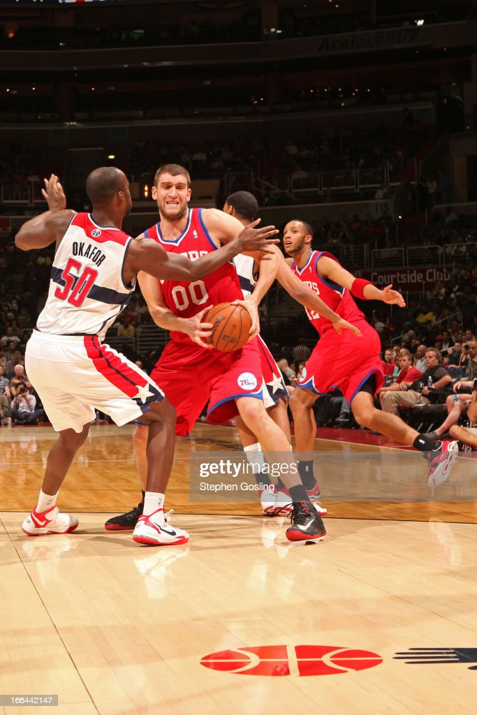 <a gi-track='captionPersonalityLinkClicked' href=/galleries/search?phrase=Spencer+Hawes&family=editorial&specificpeople=3848319 ng-click='$event.stopPropagation()'>Spencer Hawes</a> #00 of the Philadelphia 76ers looks to drive to the basket against the Washington Wizards at the Verizon Center on April 12, 2013 in Washington, DC.