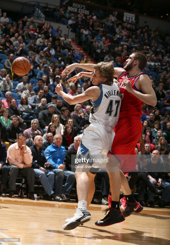 Spencer Hawes #00 of the Philadelphia 76ers passes the ball around Andrei Kirilenko #47 of the Minnesota Timberwolves during the game between Philadelphia 76ers and the Minnesota Timberwolves on February 20, 2013 at Target Center in Minneapolis, Minnesota.