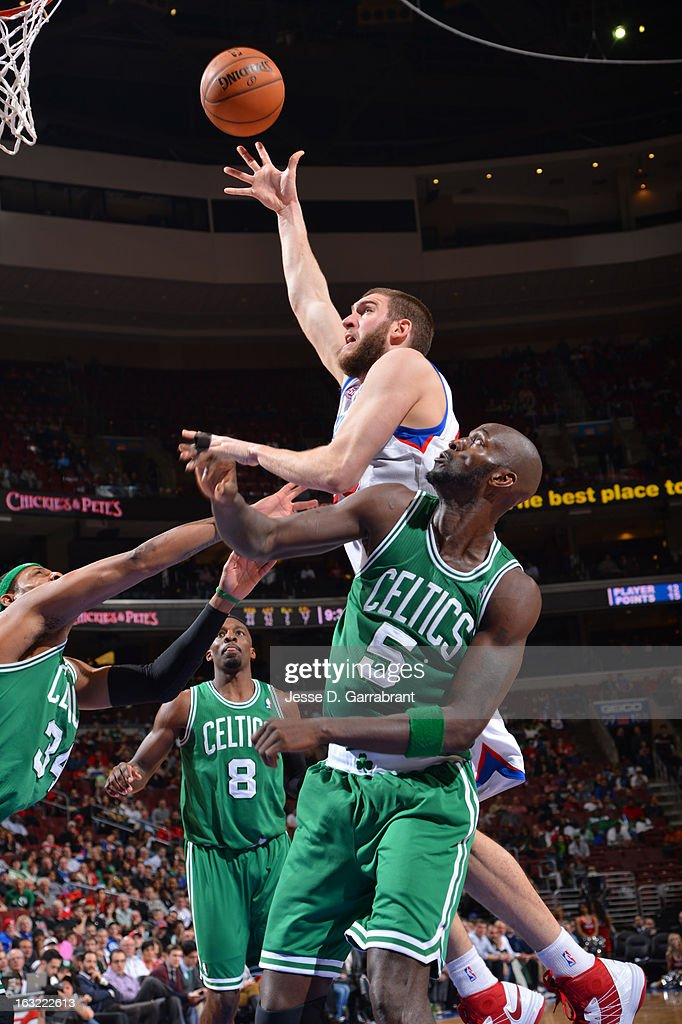 Spencer Hawes #00 of the Philadelphia 76ers puts up a shot against the Boston Celtics on March 5, 2013 at the Wells Fargo Center in Philadelphia, Pennsylvania.