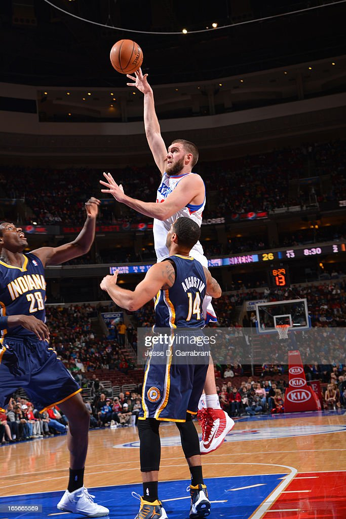 <a gi-track='captionPersonalityLinkClicked' href=/galleries/search?phrase=Spencer+Hawes&family=editorial&specificpeople=3848319 ng-click='$event.stopPropagation()'>Spencer Hawes</a> #00 of the Philadelphia 76ers puts up a shot against the Indiana Pacers at the Wells Fargo Center on March 16, 2013 in Philadelphia, Pennsylvania.