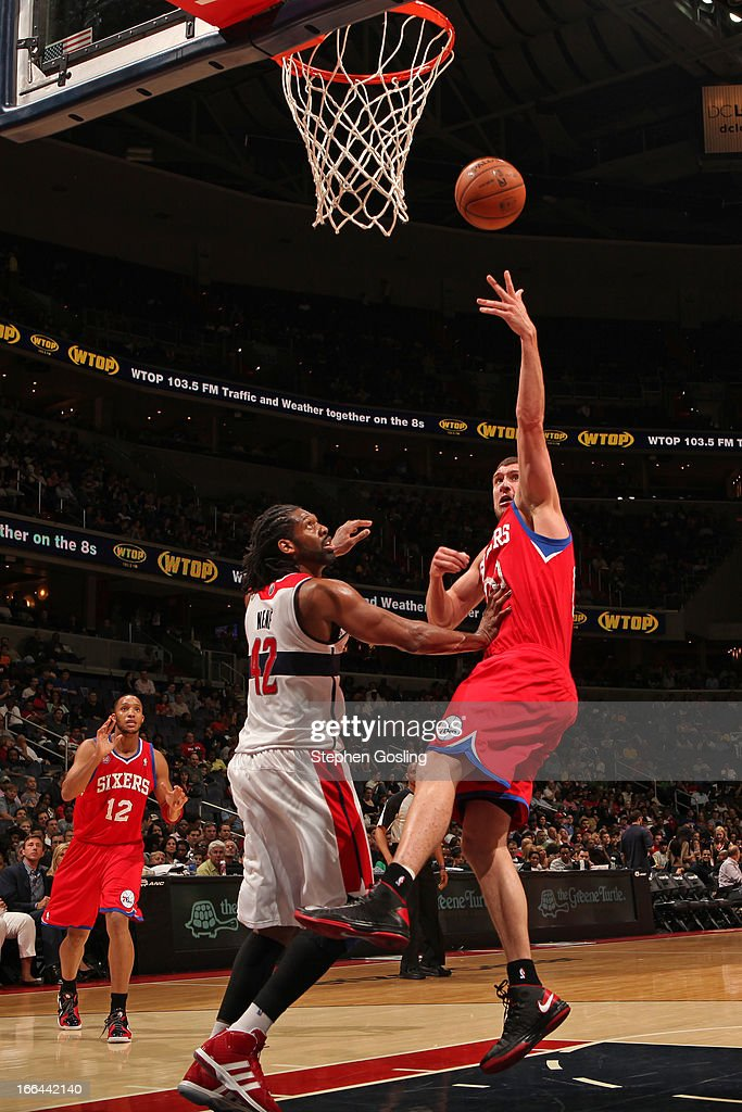 <a gi-track='captionPersonalityLinkClicked' href=/galleries/search?phrase=Spencer+Hawes&family=editorial&specificpeople=3848319 ng-click='$event.stopPropagation()'>Spencer Hawes</a> #00 of the Philadelphia 76ers puts up a shot against the Washington Wizards at the Verizon Center on April 12, 2013 in Washington, DC.