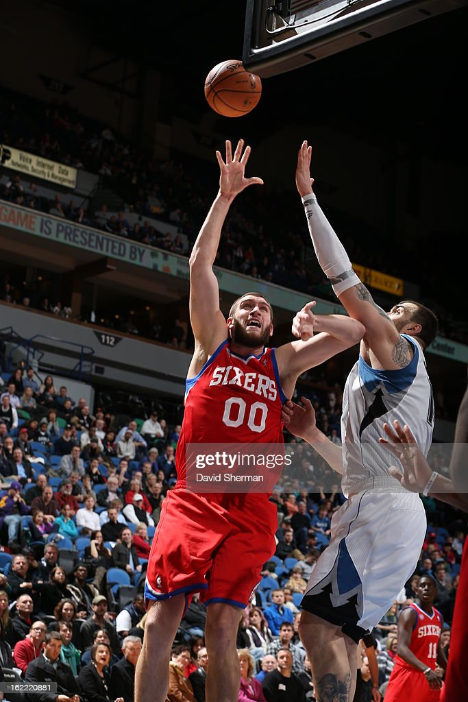 Spencer Hawes #00 of the Philadelphia 76ers reaches for the ball during the game between Philadelphia 76ers and the Minnesota Timberwolves on February 20, 2013 at Target Center in Minneapolis, Minnesota.