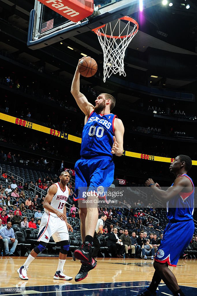 Spencer Hawes #00 of the Philadelphia 76ers rebounds against the Atlanta Hawks on March 6, 2013 at Philips Arena in Atlanta, Georgia.