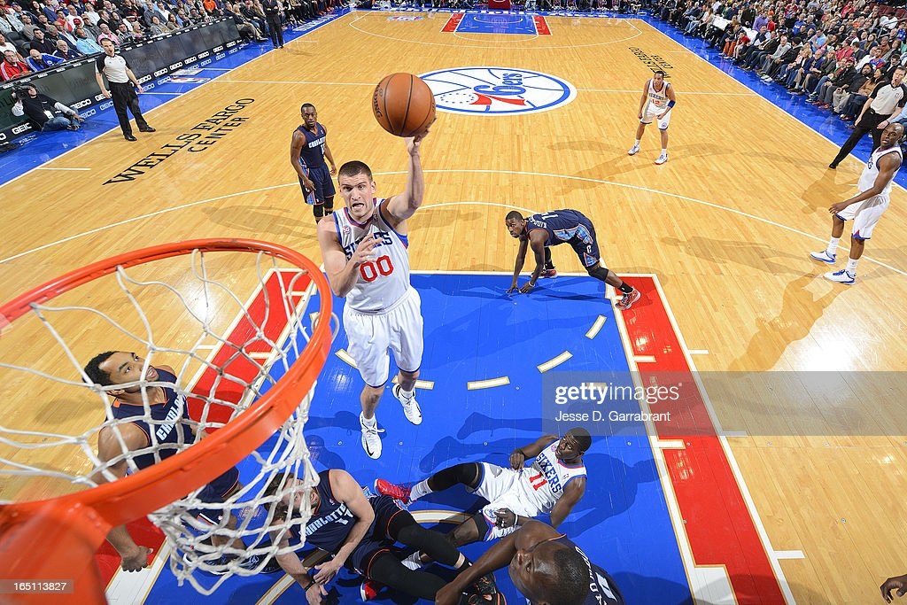 Spencer Hawes #00 of the Philadelphia 76ers shoots a layup against the Charlotte Bobcats at the Wells Fargo Center on March 30, 2013 in Philadelphia, Pennsylvania.