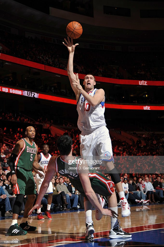 <a gi-track='captionPersonalityLinkClicked' href=/galleries/search?phrase=Spencer+Hawes&family=editorial&specificpeople=3848319 ng-click='$event.stopPropagation()'>Spencer Hawes</a> #00 of the Philadelphia 76ers shoots against <a gi-track='captionPersonalityLinkClicked' href=/galleries/search?phrase=Ersan+Ilyasova&family=editorial&specificpeople=557070 ng-click='$event.stopPropagation()'>Ersan Ilyasova</a> #7 of the Milwaukee Bucks during the game on January 14, 2011 at the Wells Fargo Center in Philadelphia, Pennsylvania.