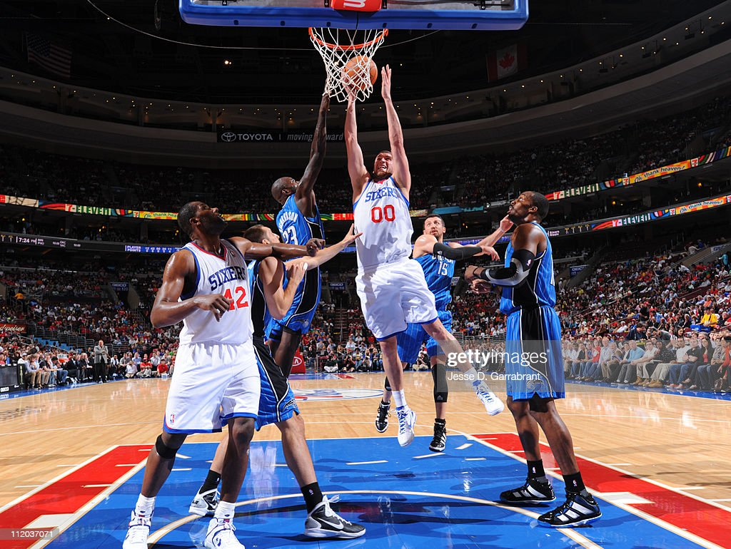 <a gi-track='captionPersonalityLinkClicked' href=/galleries/search?phrase=Spencer+Hawes&family=editorial&specificpeople=3848319 ng-click='$event.stopPropagation()'>Spencer Hawes</a> #00 of the Philadelphia 76ers shoots against <a gi-track='captionPersonalityLinkClicked' href=/galleries/search?phrase=Jason+Richardson+-+Basketball+Player+-+Born+1981&family=editorial&specificpeople=201558 ng-click='$event.stopPropagation()'>Jason Richardson</a> #23 of the Orlando Magic on April 11, 2011 at the Wells Fargo Center in Philadelphia, Pennsylvania.